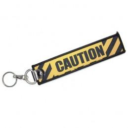 Přívěsek na klíče CAUTION, varování