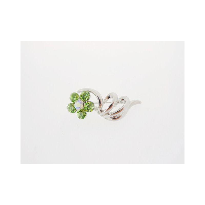 Brož se zelenou květinou